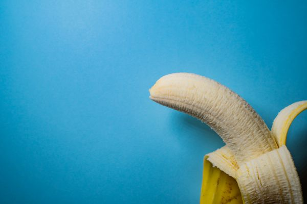 Half-Peeled Banana on Blue