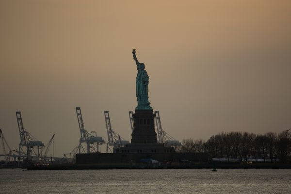 Statue of Liberty Against Orange Sky