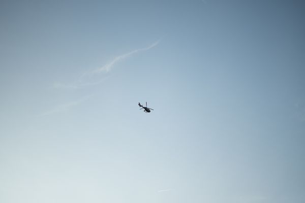 Helicopter overhead in the sky